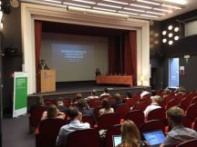 Gertjan Willems introducing keynote speaker Lucy Mazdon